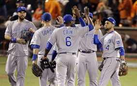 The Kansas City Royals celebrate after their 3-2 win over the San Francisco Giants in Game 3 of baseball's World Series Friday, Oct. 24, 2014, in San Francisco. The Royals lead the series 2-1. (AP Photo/Charlie Riedel)
