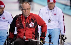 (Centre) Sanford's Dennis Thiessen is vice-skip on Canada's wheelchair curling team, which is undefeated so far at the 2014 Sochi Paralympic Games.