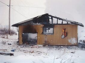 A burned out house is pictured in January, 2011 in St. Theresa Point First Nation, Man. Manitoba's fire commissioner David Schafer told an inquest examining two fatal fires on Manitoba reserves that regular inspections of band homes could simply look for working smoke detectors and multiple exits in case of fire.
