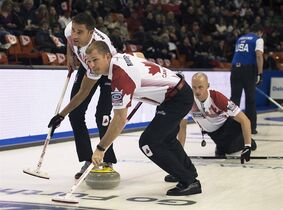 Team Canada's John Morris, left, and Carter Rycroft sweep as Nolan Thiessen, right, follows his rock as they play Team USA at the men's World Curling Championships in Halifax on Saturday, March 28, 2015. THE CANADIAN PRESS/Andrew Vaughan
