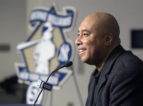 New York Yankees' Bernie Williams speaks to members of the media after unveiling a logo related to his upcoming number retirement and Monument Park plaque dedication at a news conference prior to an interleague baseball game against the New York Mets, Friday, April 24, 2015, at Yankee Stadium in New York. (AP Photo/Bill Kostroun)