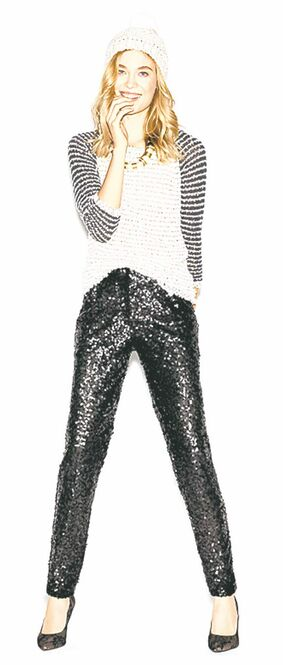 A model wears an elliptical hem sweater ($59.50), sequin pant ($98), knit hat ($24.50) and resin and pearl necklace ($49.50) from Loft.
