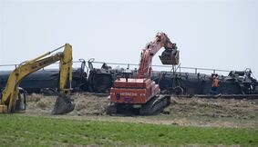 Crews work to clean up five Canadian Pacific Railway Ltd. tankers containing oils that derailed near Jansen, Sask. on Tuesday, May 21, 2013. THE CANADIAN PRESS/Liam Richards.