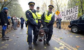 RCMP officers take a protester into custody at an anti-pipeline demonstration in Burnaby, B.C., on Nov. 20, 2014. A civil liberties group says newly disclosed Canadian Security Intelligence Service records on protest surveillance bolster its formal complaint that spies went too far in eyeing environmental activists. THE CANADIAN PRESS/Jonathan Hayward