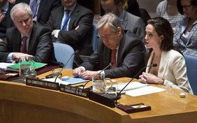 U.N. High Commissioner for Refugees Ant�nio Guterres, center, and British U.N. ambassador Mark Grant, left, listens as U.N. Special Envoy for Refugees Angelina Jolie , right, brief the U.N. Security Council on Syria's refugee crisis, Friday, April 24, 2015. (AP Photo/Bebeto Matthews)
