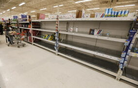 With a run on bottled water earlier in the day, late-night shoppers were were greeted with empty shelves after Winnipeg authorities issued a boil water advisory Tuesday.