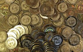 This April 3, 2013 file photo shows bitcoin tokens in Sandy, Utah. The lack of regulation and high level of anonymity of Bitcoins may make the virtually currency