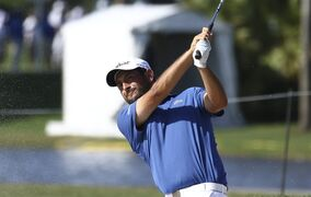 Alexander Levy of France, hits from a bunker on the 17th during the first round of the Cadillac Championship golf tournament in Doral, Fla., Thursday, March 5, 2015. (AP Photo/J Pat Carter)
