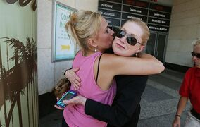 Wendy Fitzpatrick of Absecon, N.J., left, hugs employee Ruth Ann Joyce of Gloucester County N.J., Sunday, Aug. 31 2014, as the Showboat casino in Atlantic City closed for business. (AP Photo/The Press of Atlantic City, Ben Fogletto)