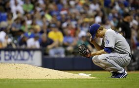 Los Angeles Dodgers starting pitcher Zack Greinke pauses behind the mound before throwing in the third inning of a baseball game against the Milwaukee Brewers Tuesday, May 21, 2013, in Milwaukee. (AP Photo/Morry Gash)