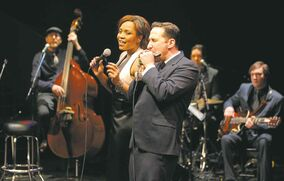 Raoul Bhaneja, right, and Divine Brown, backed by the Big Time in Prairie Theatre Exchange's Life, Death and the Blues.