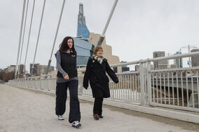 Dr. Adrienne Leslie-Toogood (L) takes a walk across the Esplanade Riel bridge along with her mother  Jody Miles.  Leslie-Toogood is the director of sports psychology at the Canadian Sport Centre Manitoba and often walks to maintain good health.