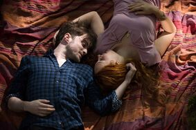 Actors Daniel Radcliffe and Juno Temple are shown in a scene from the film