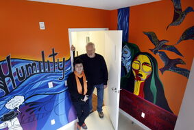 Sandy Staples, Senior Youth Care Practitioner, with Paul Johnston, recently retired as Macdonald Youth Services (MYS) Director of Client Services, in one of the bedrooms of the MYS Youth Resource Centre and Emergency Shelter located at 159 Mayfair Ave.