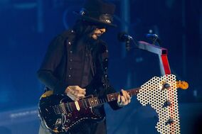 Motley Crue lead guitarist Mick Mars plays during the group's concert Wednesday, July 2, 2014, in Grand Rapids, Mich. Before Motley Crue's depraved decadence became the subject of glam-metal lore, the band got a huge publicity boost from an unlikely source: Canada. THE CANADIAN PRESS/AP Photo/Grand Rapids Press, Joel Bissell