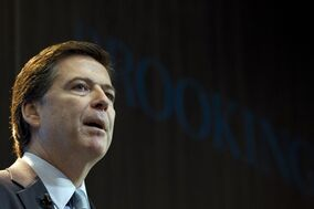 "FBI Director James Comey speaks about the impact of technology on law enforcement, Thursday, Oct. 16, 2014, at Brookings Institution in Washington. Comey gave a stark warning Thursday against smartphone data encryption, saying homicide cases could be stalled, suspects could go free and ""justice may be denied because of a locked phone or an encrypted hard drive."" (AP Photo/Jose Luis Magana)"