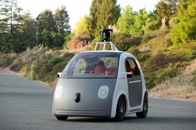 This undated image provided by Google, shows an early version of Google's prototype self-driving car. For the first time, California's Department of Motor Vehicles knows how many self-driving cars are traveling on the state's public roads. The agency is issuing permits, Tuesday, Sept. 16, 2014 that let three companies test 29 vehicles on highways and in neighborhoods. (AP Photo/Google, File)
