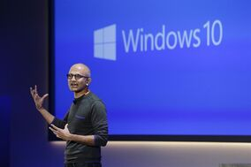 This Jan. 21, 2015 photo shows Microsoft CEO Satya Nadella speaking at an event demonstrating new features of its flagship operating system Windows at the company's headquarters in Redmond, Wash. Microsoft will report earnings Thursday April 23, 2015. (AP Photo/Elaine Thompson)