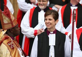 The Rev. Libby Lane smiles as Archbishop of York Dr John Sentamu looks on after her consecration as the eighth Bishop of Stockport, at York Minster, England, Monday Jan. 26, 2015. Male domination in the leadership of the Church of England is coming to an end, as the 500-year-old institution consecrates its first female bishop. (AP Photo/PA, Lynne Cameron) UNITED KINGDOM OUT NO SALES NO ARCHIVE