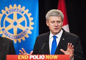 Prime Minister Stephen Harper speaks at the Rotary Foundation meeting where he received a Polio Eradication Champion Award in Toronto on Saturday, October 18, 2014. THE CANADIAN PRESS/Aaron Vincent Elkaim