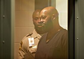 """Rap music mogul Marion """"Suge"""" Knight appears in court on a traffic warrant Thursday, Oct. 30, 2014, in Las Vegas following his arrest as a fugitive in a California robbery case. Thursday's court appearance for the 49-year-old founder of Death Row Records stems from a suspended license charge in Las Vegas. Knight and comedian Katt Williams were arrested and charged with robbery Wednesday after a celebrity photographer reported the men stole her camera on Sept. 5 in Beverly Hills, Calif. (AP Photo/John Locher)"""