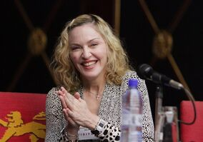 FILE - In this Nov. 28, 2014 file photo, Madonna visits Malawian President Peter Mutharika at State House in Lillongwe Malawi. In a surprise preview of her new album, Madonna released six songs Saturday, Dec. 20, 2014, on iTunes and various streaming services. The songs were released because several in-progress demos were leaked earlier this week, according to Madonna publicist Liz Rosenberg. (AP Photo/Tsvangirayi Mukwazhi)