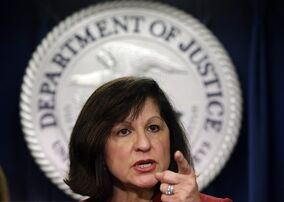 United States Attorney Carmen Ortiz announces indictments of 14 owners and employees from the New England Compounding Center Wednesday, Dec. 17, 2014, in Boston. More than 750 people in 20 states were sickened, and 64 died after they contracted fungal meningitis and other illnesses in 2012 from tainted steroids made by the Framingham, Mass., company. (AP Photo/Steven Senne)