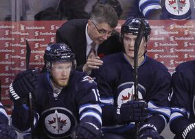Noel -- giving some pointers to rookie Mark Scheifele in a November 2013 game at the MTS Centre -- says it's the teaching he enjoys about coaching.