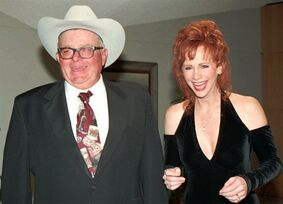 File-This file photo from 1995 shows Reba McEntire, right, and her