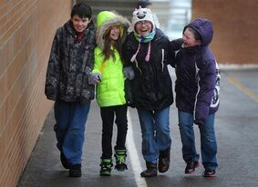 Chirlden walk during recess on Thursday in Sioux Falls, S.D. Jan. 10, 2013. Fewer Canadian kids are commuting by walking or biking as a new report reveals a marked decline among young people using active modes of transportation. THE CANADIAN PRESS/AP/The Argus Leader,Jay Pickthorn ) NO SALES (AP Photo / Argus Leader, Jay Pickthorn