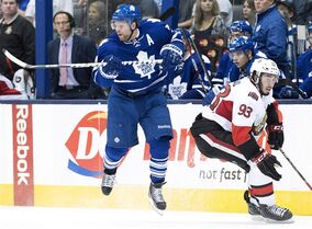 Toronto Maple Leafs forward Phil Kessel, left, avoids a hit from Ottawa Senators forward Mika Zibanejad during pre-season NHL hockey action in Toronto on Wednesday, September 24, 2014. The game between the Senators and Maple Leafs that was postponed because of Wednesday's shooting on Parliament Hill has been rescheduled for Nov. 9 at 6 p.m. at Canadian Tire Centre. THE CANADIAN PRESS/Nathan Denette