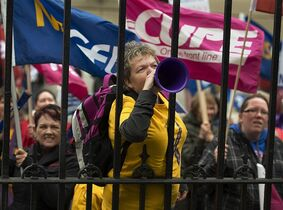 Protesters from public sector unions march outside the legislature in Halifax on Monday, September 29, 2014. The Nova Scotia government is introducing a bill that would merge the number of bargaining units in the health-care sector from 50 to four by April 1. THE CANADIAN PRESS/Andrew Vaughan