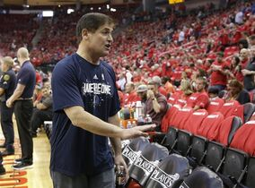 Dallas Mavericks owner Mark Cuban looks for his seat before Game 1 in the first round of the NBA basketball playoffs Saturday against the Houston Rockets, April 18, 2015, in Houston. (AP Photo/David J. Phillip)