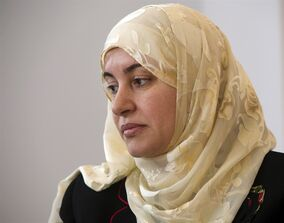 Rania El-Alloul takes part in a news conference Friday, March 27, 2015, in Montreal. El-Alloul is seeking a declaratory judgment after a Quebec judge refused to hear her case because she was wearing a hijab. THE CANADIAN PRESS/Ryan Remiorz