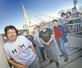 Donna Harris (left) stands with other members of the Humanists, Atheists and Agnostics of Manitoba. Harris, who doesn't believe in God, says she's curious about how people conclude there is a supreme being.