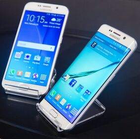 In this Monday, Feb. 23, 2015 photo, two new Samsung phones, Galaxy S6, left, and Galaxy S6 Edge, right, are shown at a special press preview in New York. Samsung officially unveiled the stylish new phones on Sunday, March 1, 2015, the eve of this week's Mobile World Congress wireless show in Barcelona, Spain. (AP Photo/Bebeto Matthews)