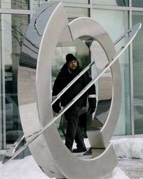 A security guards patrols Nortel Networks' corporate headquarters in Toronto, Ont. on Wednesday, January 14, 2009. Competing groups of creditors at the Nortel bankruptcy trial are focusing on the legal interpretation of a 10-year-old agreement to determine how to divide billions of dollars in proceeds from the sale of Nortel's patents and intellectual property.THE CANADIAN PRESS/Darren Calabrese
