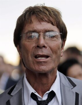 "FILE - In this Friday July 27, 2012 file photo, British singer Cliff Richard arrives for the opening ceremony at the 2012 Summer Olympics, in London. A police investigation of veteran pop star Cliff Richard relating to claims of sexual assault has ""increased significantly in size,"" a British lawmaker said Wednesday Feb. 25, 2015. (AP Photo/Markus Schreiber, File)"
