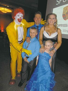 Alyx Delaloye, brother Hayden, parents Reg and Jody and some guy named Ronald.
