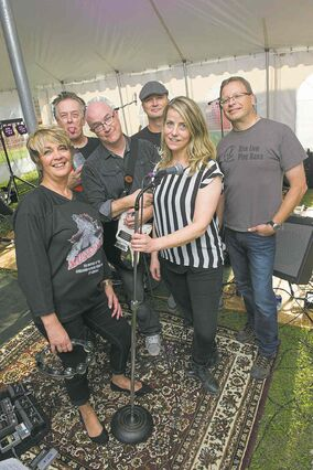 Lori Wolstencroft (from left), Rick Carpick, Grant Smith, Ted Wolstencroft, Karin Krueger, and Rob Smith make up the band Fighting Hellfish which performed at the Dragonboat Festival social & dance at the Rowing Club Saturday evening.