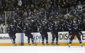 The San Jose Sharks celebrate a goal by Patrick Marleau (12) during the second period of an NHL hockey game against the Anaheim Ducks on Thursday, Jan. 29, 2015, in San Jose, Calif. (AP Photo/Marcio Jose Sanchez)