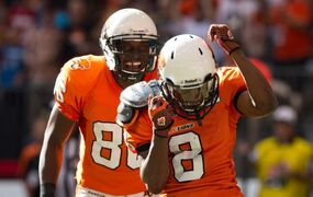 B.C.'s Korey Williams (right) and Courtney Taylor celebrate Williams' touchdown against the Bombers during the Lions' 27-20 victory in Vancouver Monday.
