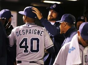 Colorado Rockies bullpen coach Darren Holmes is congratulated as he leaves the game against the Colorado Rockies during the seventh inning of a baseball game Monday, April 20, 2015, in Denver. (AP Photo/Jack Dempsey)