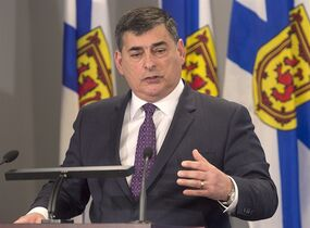 Murray Segal, a former Ontario chief prosecutor, provides an update of his investigation of aspects of the Rehtaeh Parsons case, in Halifax on Thursday, Feb. 26, 2015. Segal says his review of how police and prosecutors in Nova Scotia initially handled the case should be done in the fall. Parsons was taken off life-support after attempting suicide in 2013. Her family alleged she was sexually assaulted in November 2011 and bullied. THE CANADIAN PRESS/Andrew Vaughan