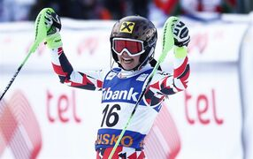 Anna Fenninger, of Austria, celebrates her first place in the finish area at the end of an alpine ski World Cup women's super-combined event, in Bansko, Bulgaria, Sunday, March 1, 2015. (AP Photo/Giovanni Auletta)
