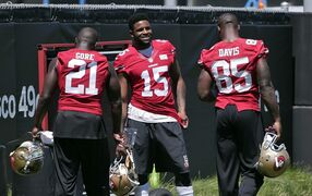 San Francisco 49ers wide receiver Michael Crabtree (15) talks with teammates Frank Gore, left, and Vernon Davis during an NFL football training camp on Friday, July 25, 2014, in Santa Clara, Calif. (AP Photo)
