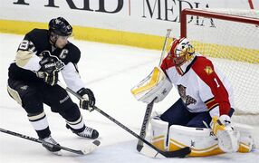 Florida Panthers goalie Roberto Luongo (1) blocks a shot by Pittsburgh Penguins' Sidney Crosby (87) during the first period of an NHL hockey game in Pittsburgh, Saturday, Dec. 20, 2014. (AP Photo/Gene J. Puskar)