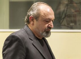 Vujadin Popovic enters the courtroom of the International Criminal Tribunal for the former Yugoslavia (ICTY) in The Hague, Netherlands, Friday, Jan. 30, 2015. Appeals judges at the ICTY have upheld genocide convictions against two senior Bosnian Serbs for their roles in the 1995 Srebrenica massacre, the first final judgment for genocide by the United Nations court. Vujadin Popovic and Ljubisa Beara, convicted of the most serious offense in the war crimes statute, were high-ranking security officers with the Bosnian Serb army that overran Muslim forces and thinly armed U.N. troops in the Srebrenica enclave in July 1995 and subsequently murdered some 8,000 Muslim men and boys, Europe's worst massacre since World War II. A small part of both men's 2010 convictions was overturned in Friday's ruling, but Presiding Judge Patrick Robinson reaffirmed their life sentences, the harshest punishment ever handed down by the court.(AP Photo/Michael Kooren, Pool)