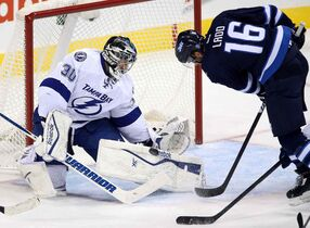 Tampa Bay Lightning goaltender Ben Bishop (30) stops Winnipeg Jets' Andrew Ladd (16) right during the first period of Friday's game.