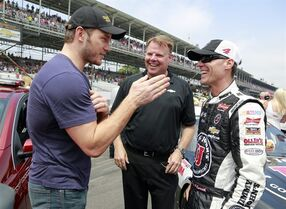 Actor Chris Pratt, left, talks with Kevin Harvick before the Brickyard 400 auto race at Indianapolis Motor Speedway in Indianapolis, Sunday, July 27, 2014. (AP Photo/R Brent Smith)